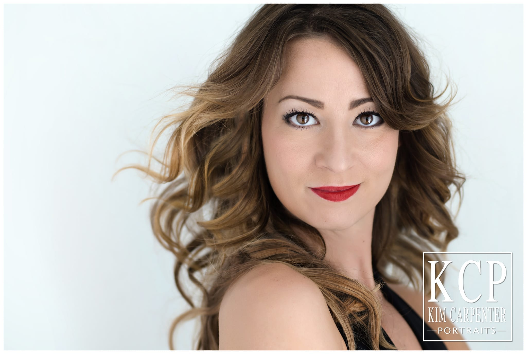 Gorgeous woman with bright red lips. Lakeland Photographer, professional headshots