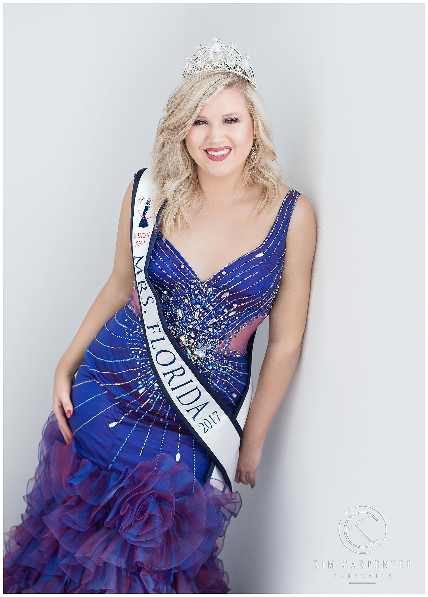 Woman wearing blue dress and sash that says Mrs. Florida.