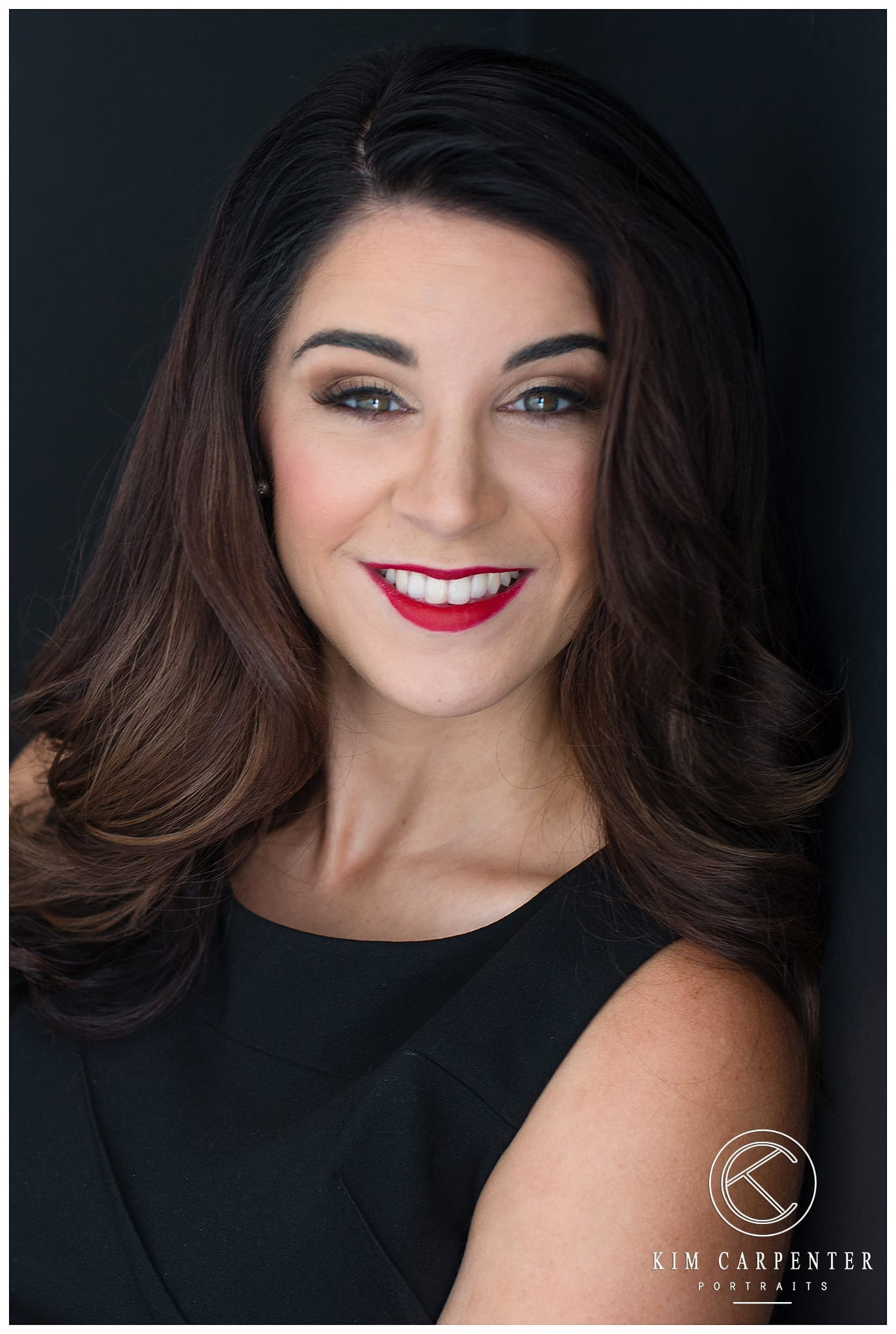 Young lady with red lipstick and white teeth. Lakeland Photographer, professional headshots