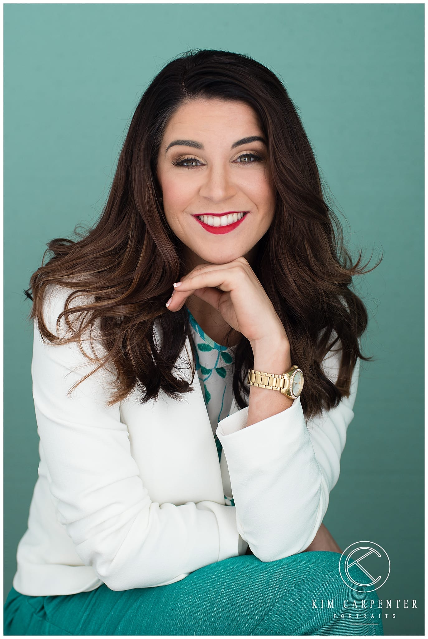 Lady wearing a white jacket and has a watch on her wrist. Lakeland Photographer, professional headshots
