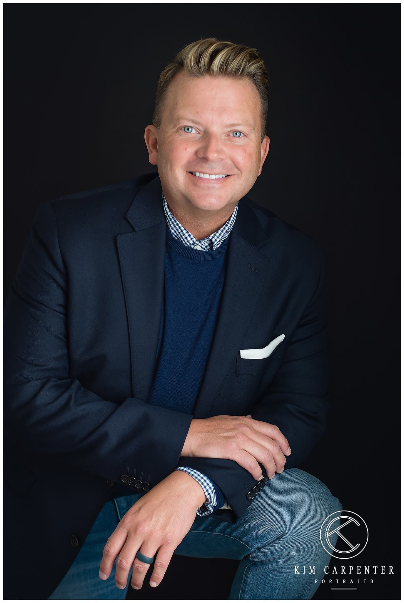 A smiling man who is posing for a professional portrait for personal branding.