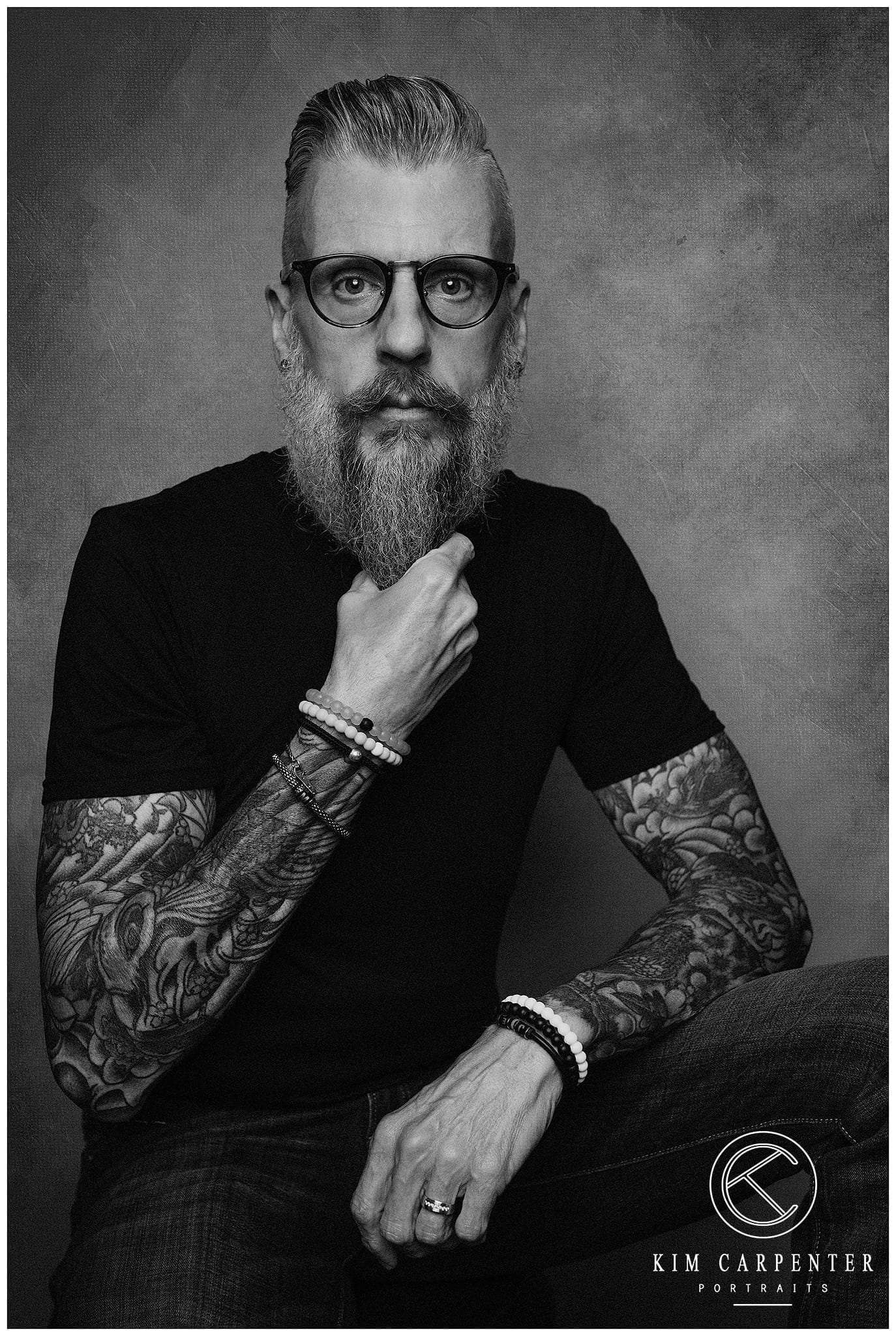 A black and white professional headshot of a local barber.