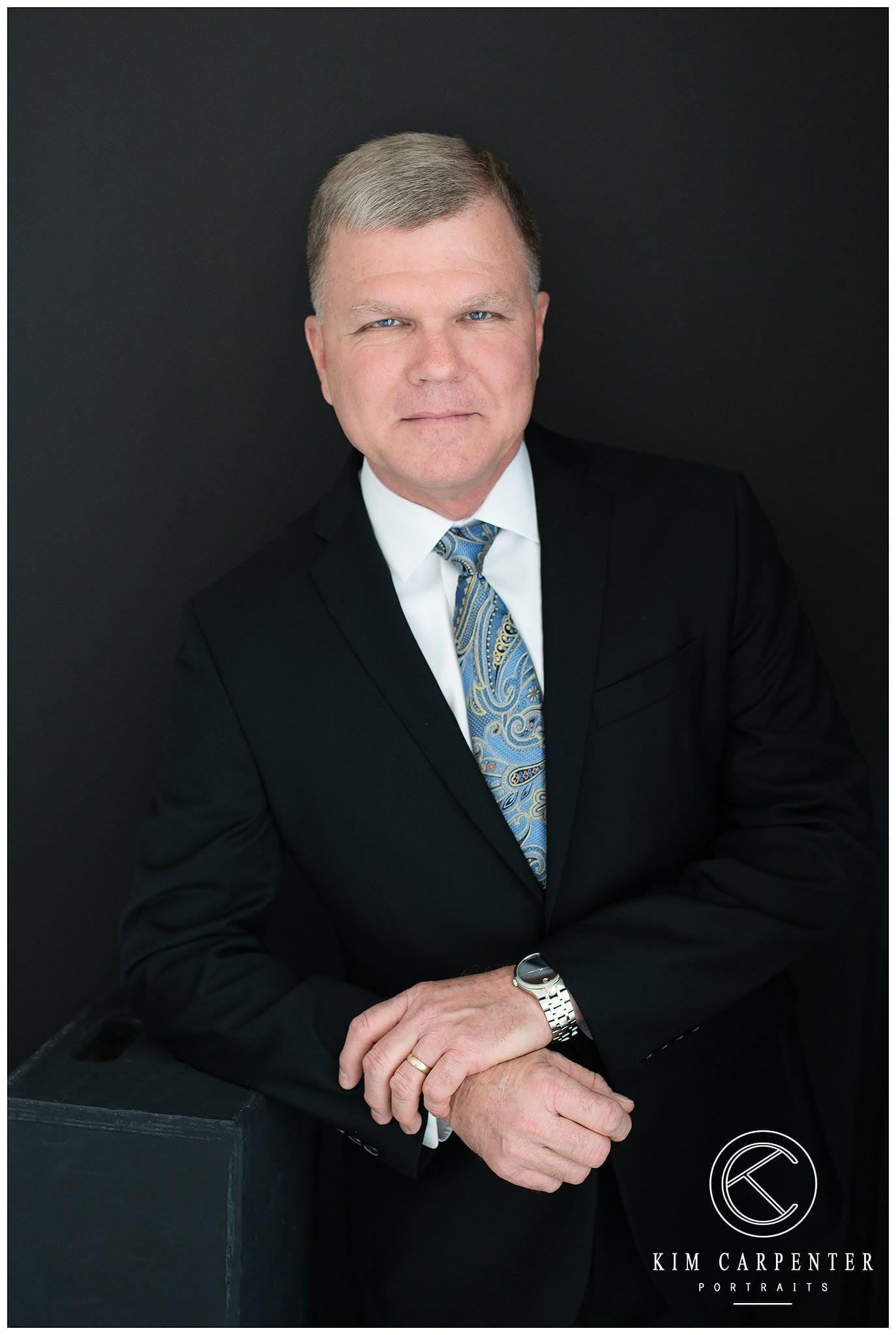 Professional headshots of a licensed insurance agent.